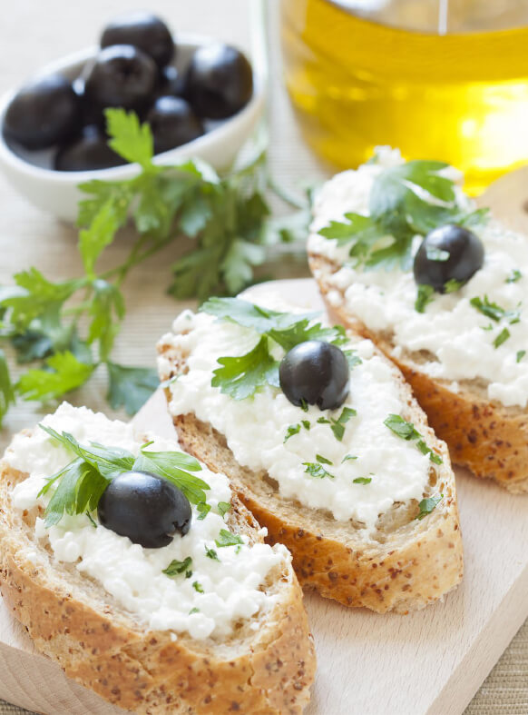 Penfield Olives food service and retail olives page pic, coriander, cottage cheese and kalamata olives on crusty bread.